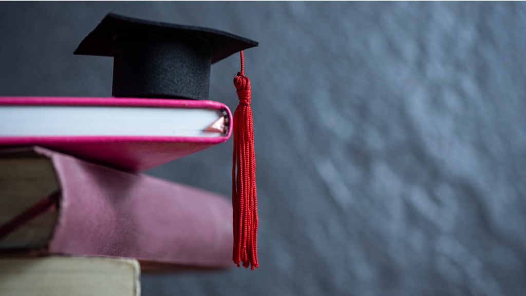 Easiest Online Associate Programs - featured image of graduation cap and college supplies